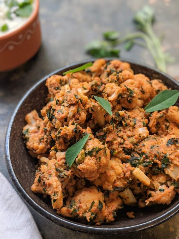 Cauliflower with fenugreek greens in spicy peanut gravy