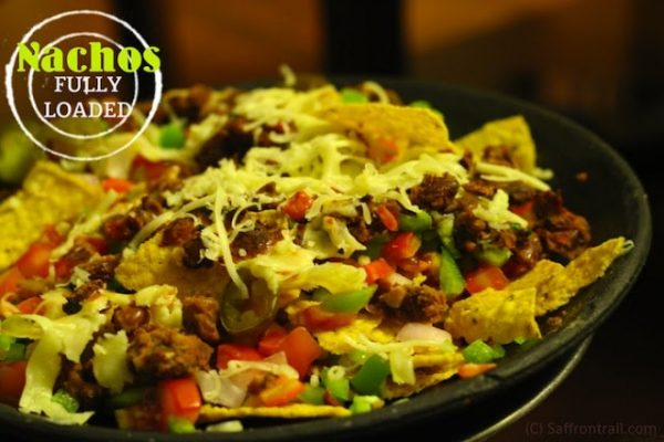 Loaded Nachos topped with refried beans & more