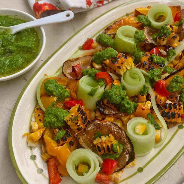 Recipe for Corn Cucumber Salad with Chimichurri Sauce, and a bunch of other colourful vegetables, a must try when corn is in season!